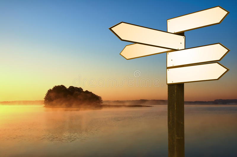 Guidepost on a lakeshore royalty free stock photos