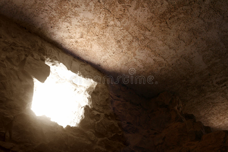 Guiding Light. A burst of bright light floods into a dark room at the ancient Masada Ruins in Israel royalty free stock photography