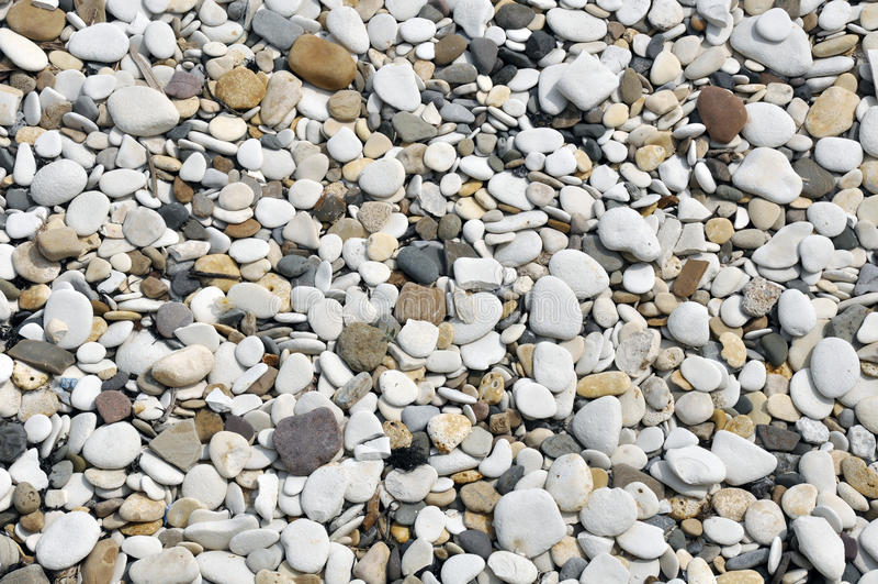 Guijarros lisos en la playa fotos de archivo libres de regalías