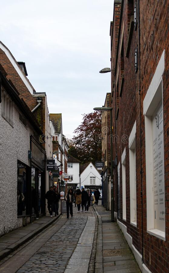 The Guildford Shambles. Guildford, United Kingdom - November 06 2019: Shoppers and stores along the tiny side street The Shambles royalty free stock photos