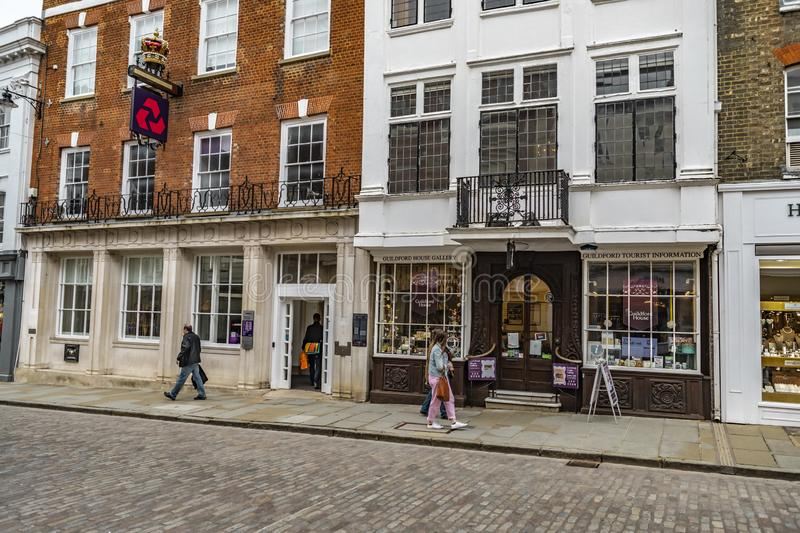 Guildford Tourist Information And House Gallery. Guildford, United Kingdom - March 23, 2019: people walking by the tourist information and house gallery in the stock images