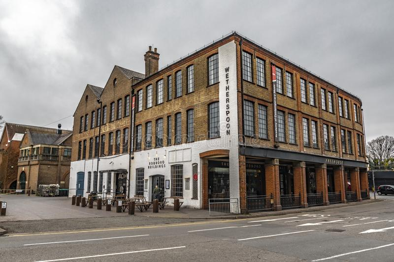 The Rodboro Buildings Of Guildford. Guildford, United Kingdom - March 23, 2019: Street view of the Rodboro buildings Wetherspoon pubs in the medieval city of royalty free stock photography