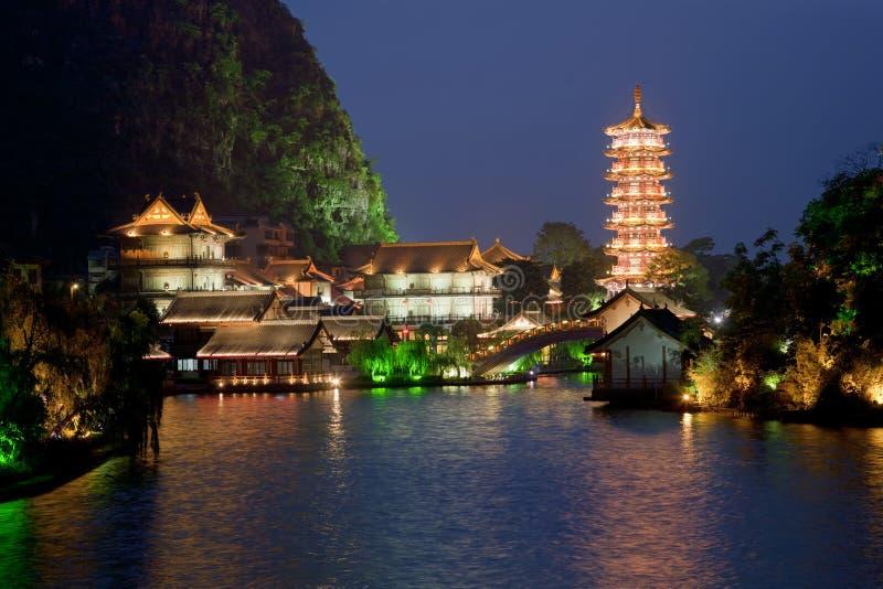Guilin China. Mulong Pagoda also known as the Mulong Tower reflected in the Mulong Lake, Mulong Lake Park, Guilin, China royalty free stock photos