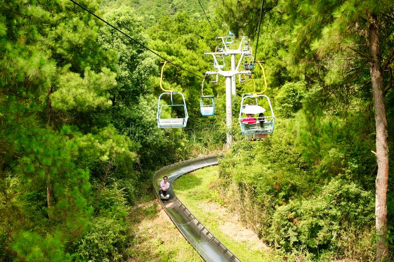 Guilin, China - July 16, 2018: Long cable car at Yaoshan Mountain. stock photos