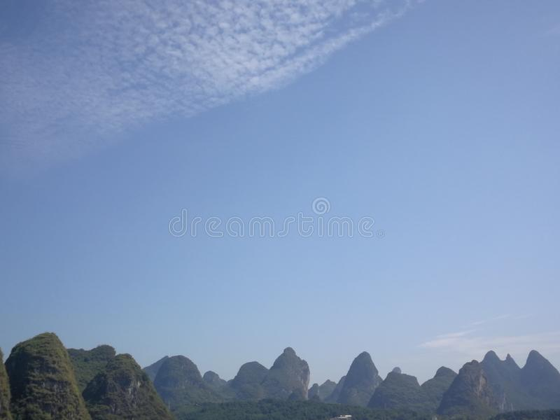 The hills of guilin. Guilin landscape, under the blue sky, rolling mountains from the ground, marveled at the charm of nature royalty free stock images