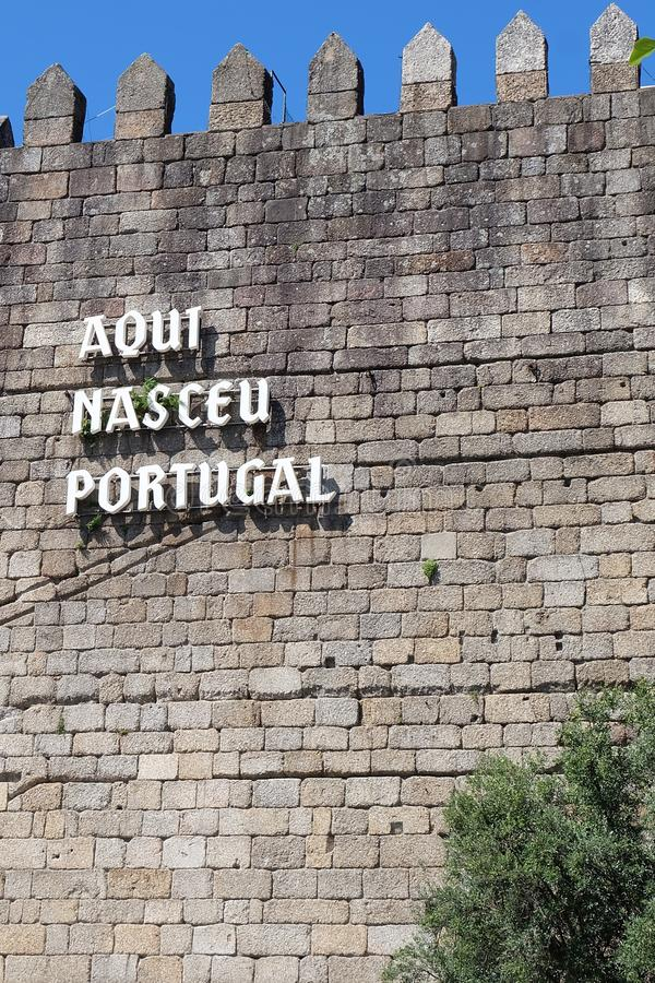 Guimaraes Castle Wall with the inscription Aqui Nasceu Portugal royalty free stock photo
