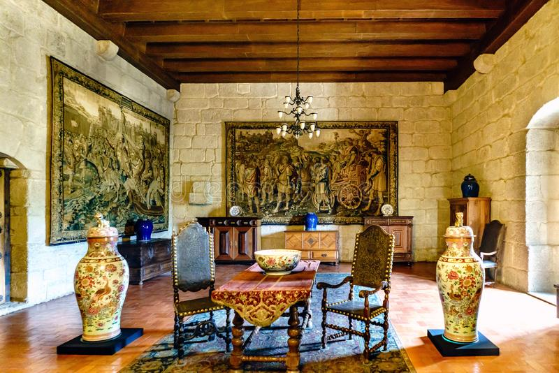 Guimaraes, Portugal. August 14, 2017: Palace Hall of the Dukes of Braganza with Chinese porcelain vases, medieval furniture and ta. Pestries embroidered on the stock image