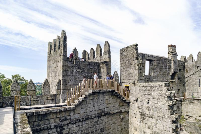 Guimaraes, Portugal. August 14, 2017: People walking through the walls of the castle of King Afonso Henriques built in the elevent royalty free stock photography