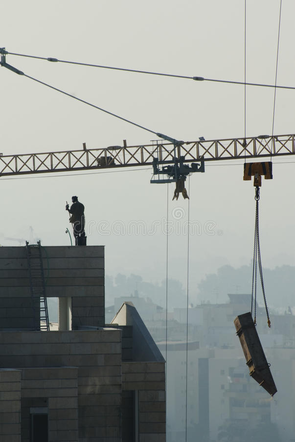 Guindaste, construção de edifícios de highrise fotografia de stock