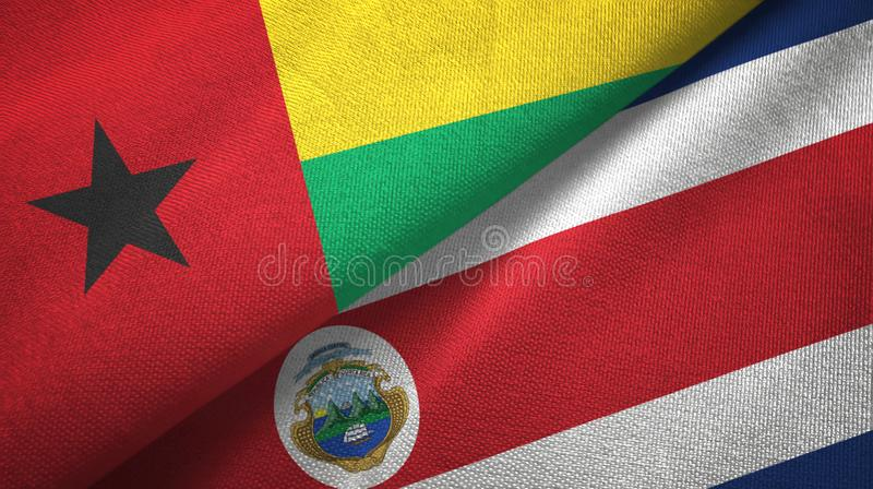 Guinea-Bissau and Costa Rica two flags textile cloth, fabric texture stock illustration