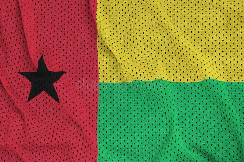 Guinea Bissau flagga som skrivs ut på ett ingrepp för polyesternylonsportswear royaltyfri fotografi