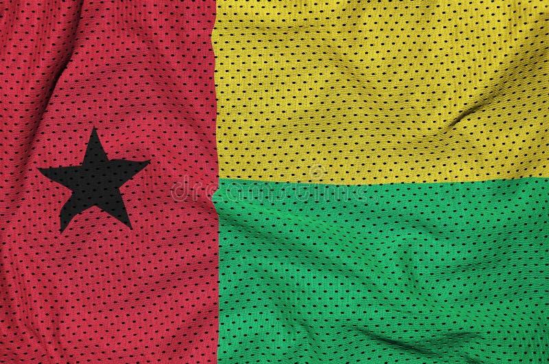 Guinea Bissau flagga som skrivs ut på ett ingrepp för polyesternylonsportswear royaltyfria bilder