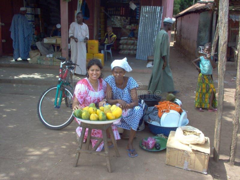 Guinea Bissau market. African women selling fruit on the street market of Africa Guinea Bissau stock photo