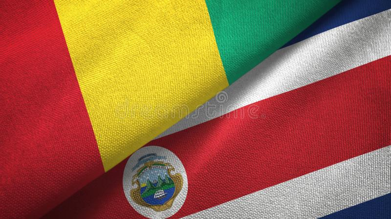 Guinea and Costa Rica two flags textile cloth, fabric texture royalty free illustration