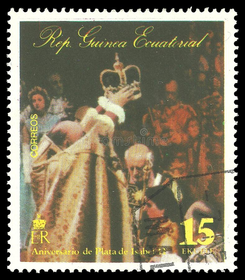Queen Elizabeth II in a coronation scene. Guinea Equatorial - stamp 1977: Color edition on 25th Coronation Anniversary, shows Queen Elizabeth II in a coronation royalty free stock photos