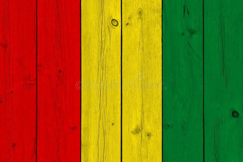 Guinea flagga som målas på gammal träplanka arkivfoton