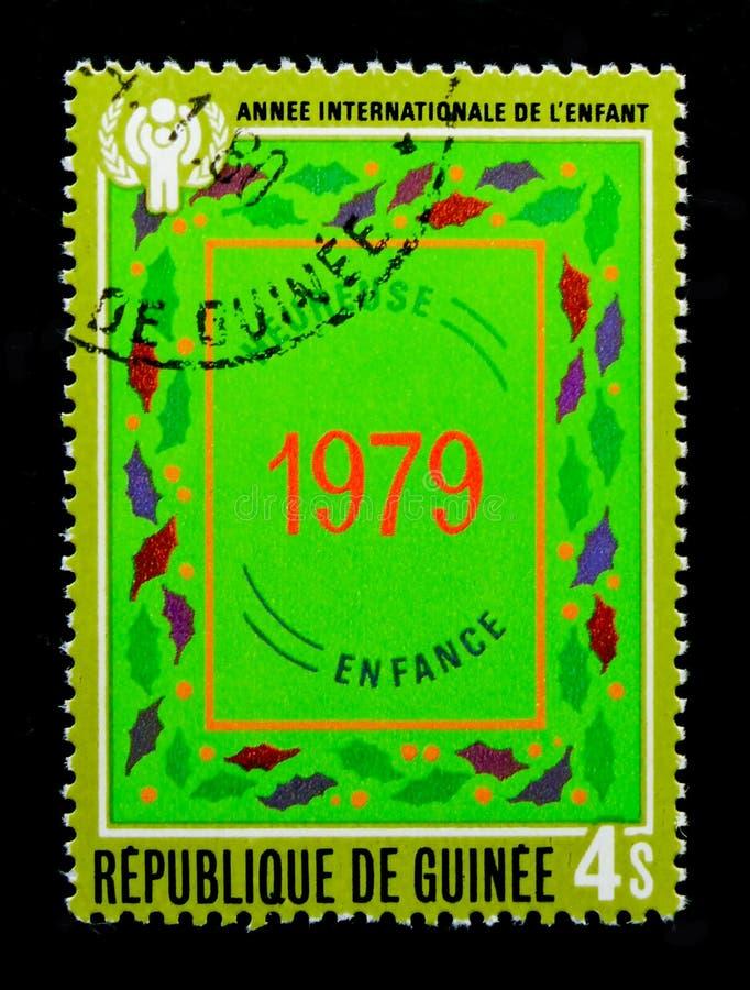 Guinea muestra a dígitos 1979, año del serie del niño, circa el an o 80 imagen de archivo libre de regalías