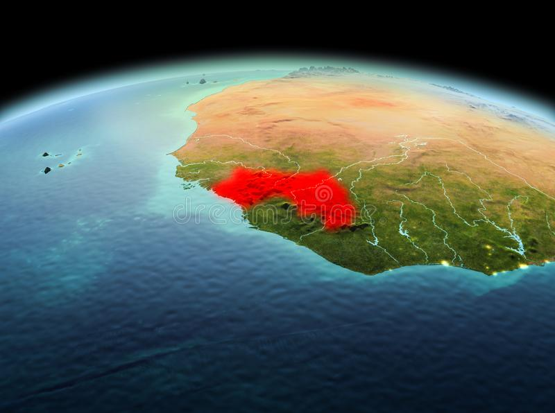 Guinea on planet Earth in space. Morning above Guinea highlighted in red on model of planet Earth in space. 3D illustration. Elements of this image furnished by royalty free stock photos