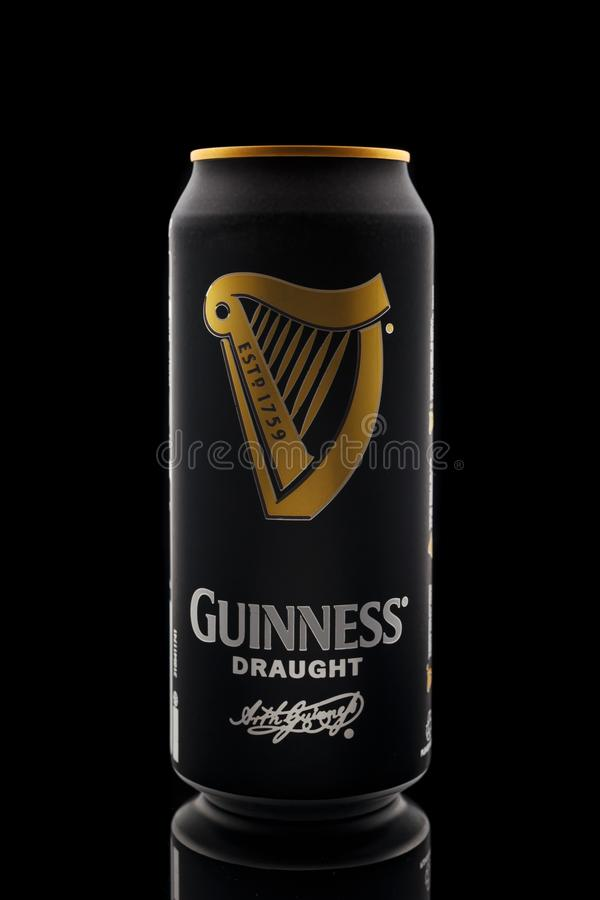 Guinness draught popular Irish beer in aluminium can on a black background, Devon, United Kingdom, October 21, 2018 royalty free stock images