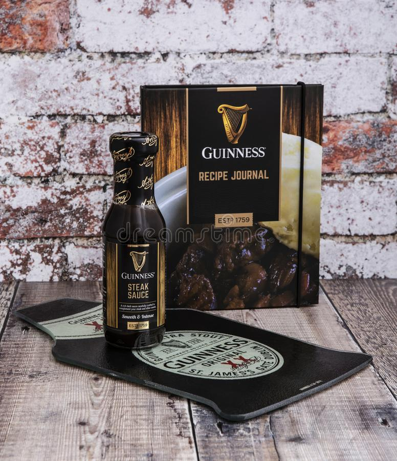 Guinness Recipe Journal and Steak Sauce on a rustic background stock image