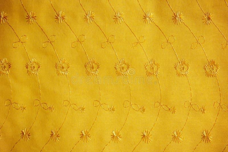 Guipur del oro, bordado en el paño para el vestido de boda, textura foto de archivo libre de regalías