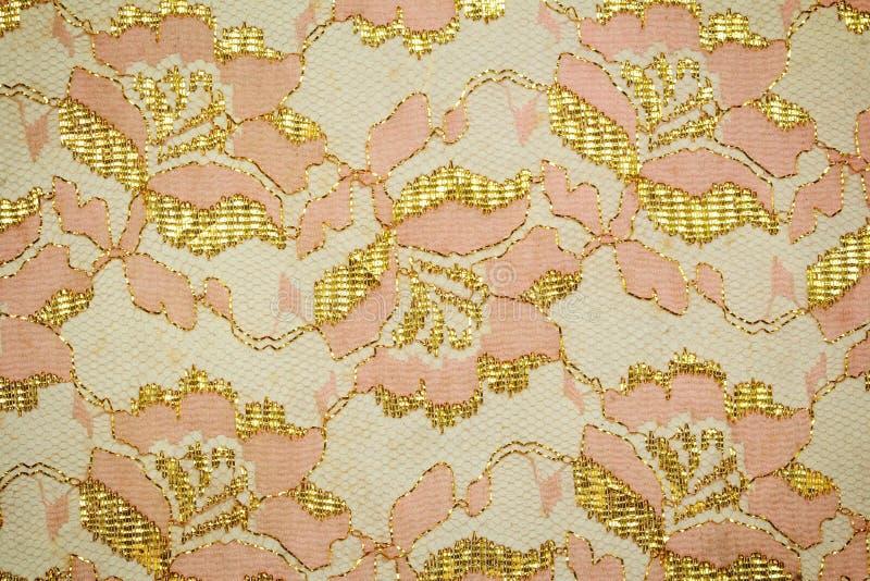 Guipure d'or, broderie sur la texture de tissu image stock