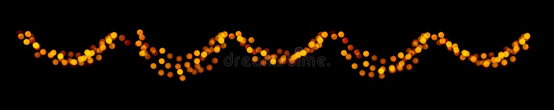 Guirlande de bokeh de Noël des cercles defocused lumineux d'or sur le fond foncé noir image stock