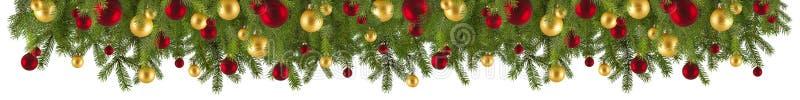 Guirlande de Noël avec des ornements et des branches de sapin photographie stock libre de droits