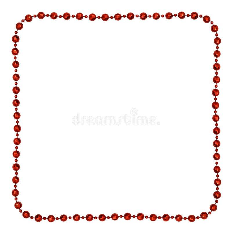 Guirlande rouge de Noël avec les perles rondes dans un cadre carré photos stock