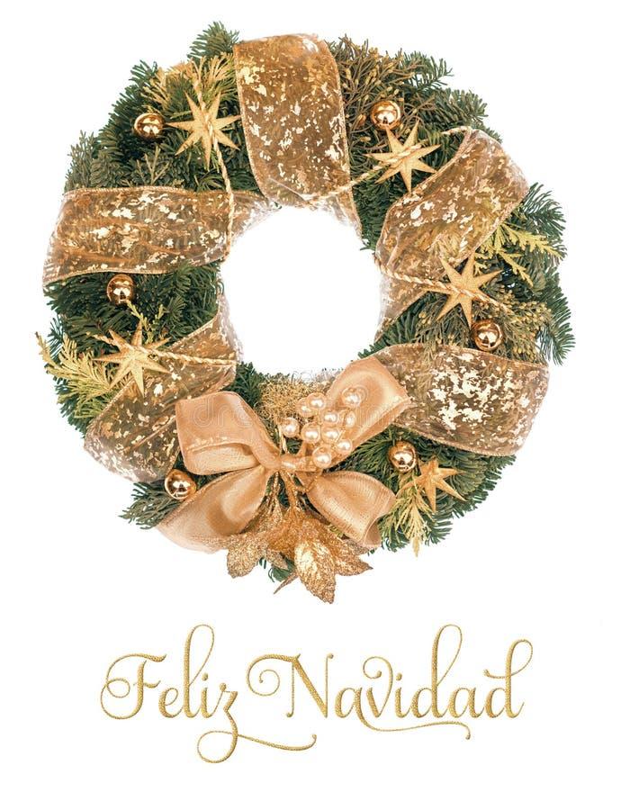 Guirnalda de la Navidad con las decoraciones de oro en el fondo blanco fotografía de archivo libre de regalías