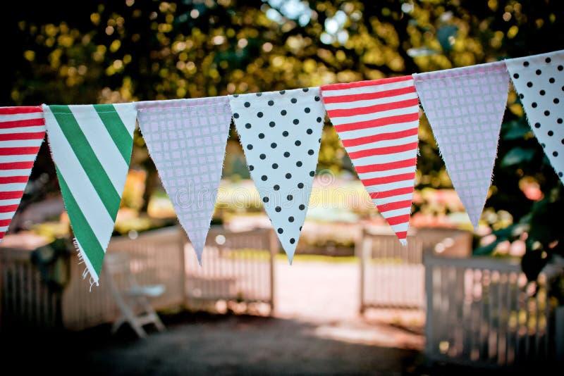 Guirnalda de las banderas de la materia textil foto de archivo libre de regalías