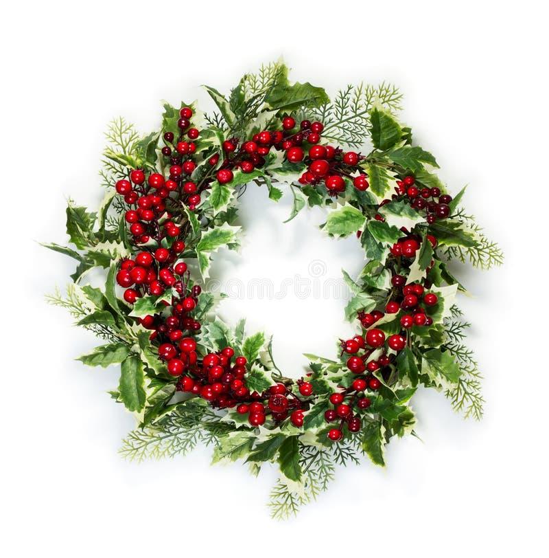 Guirnalda del acebo de la Navidad imagenes de archivo