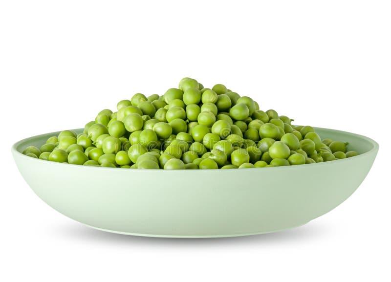 Guisante verde en el cuenco blanco aislado en el fondo blanco con la sombra Detalle para el paquete del diseño de la comida sana fotografía de archivo