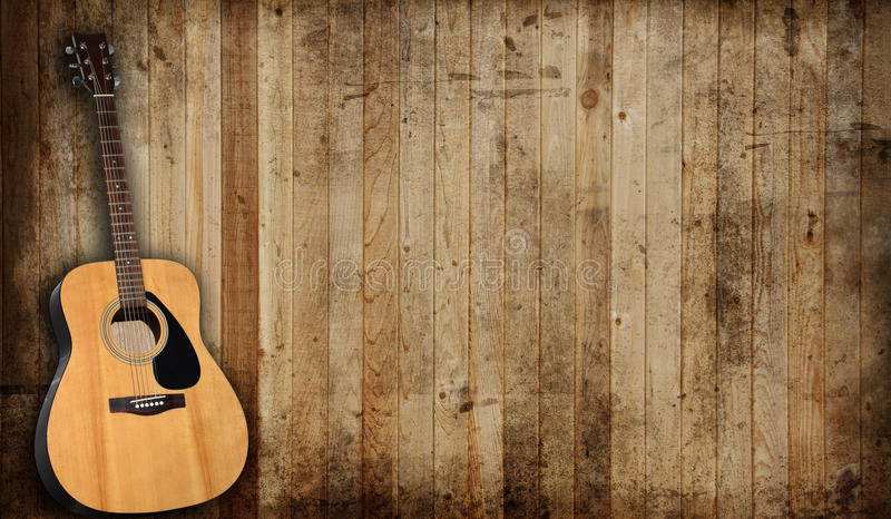 Guitar. Acoustic guitar against an old barn background