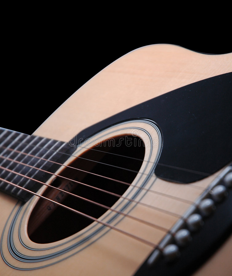 Guitar. A blur angled guitar on black background stock images