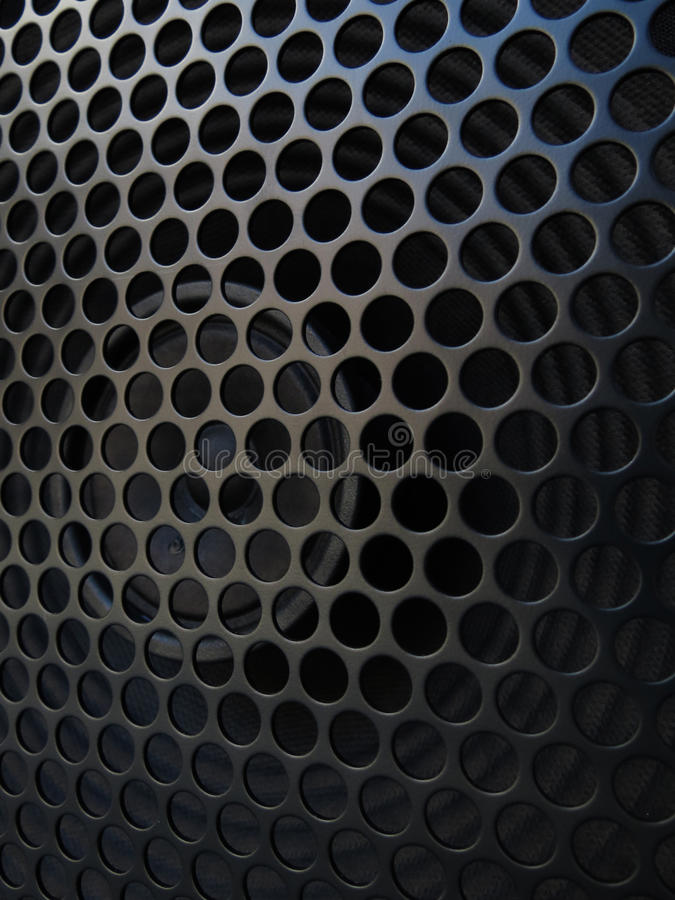 Guitar amplifier speaker with grill detail. Guitar amplifier speaker detail with a metal protective grid good for background royalty free stock photos