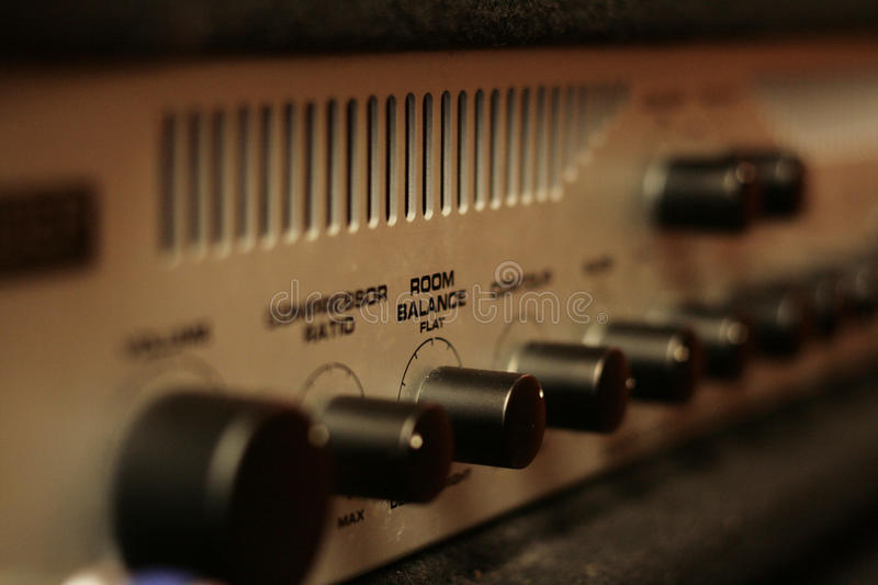 Guitar amplifier. Volume control in a guitar amplifier stock photography