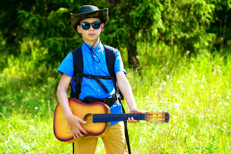 Guitar and backpack royalty free stock photo