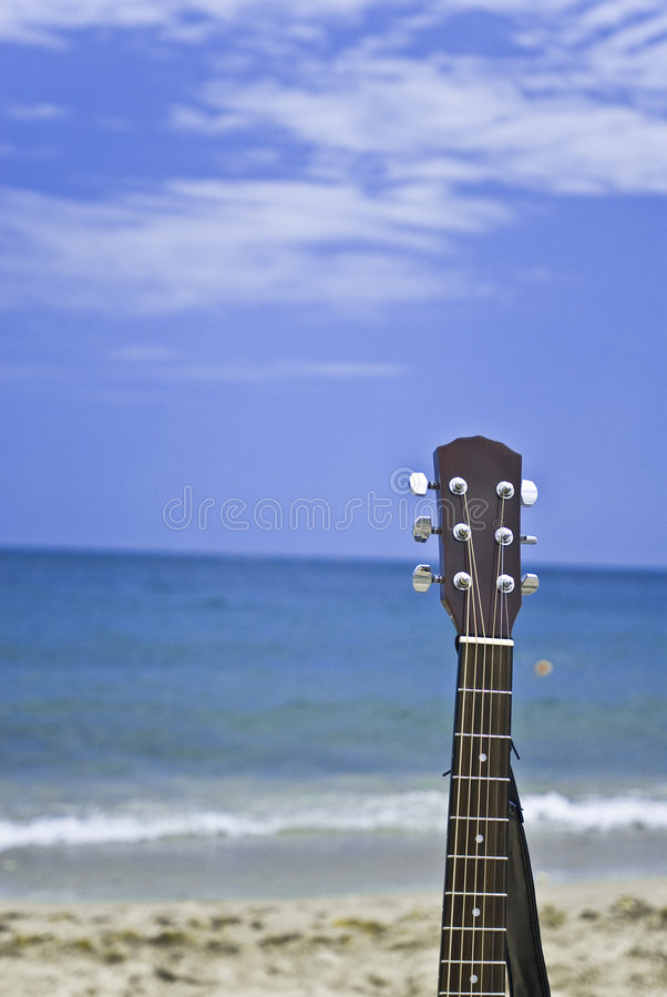 Guitar on the beach stock images