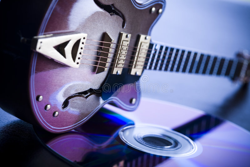 Guitar & CD. Musical instrument - classic guitar and other objects stock photography