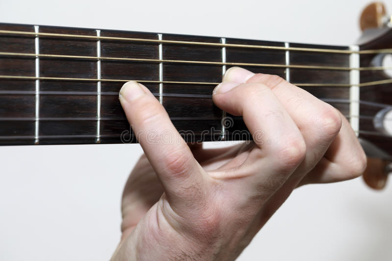 Guitar Chords. Playing Guitar close up and isolated on white royalty free stock photos