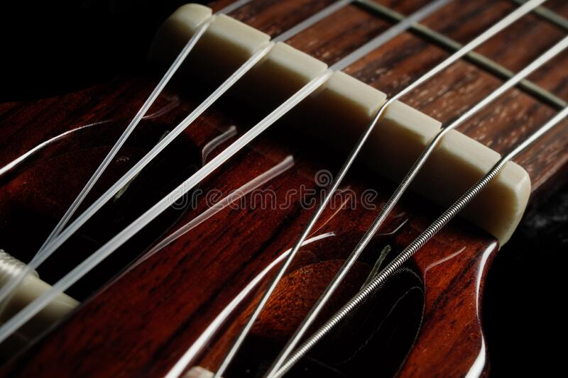 Guitar classic in dark background. Guitar classic, close up shot royalty free stock photo