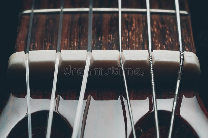 Guitar classic in dark background. Guitar classic, close up shot royalty free stock photography