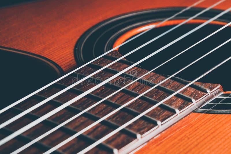 Guitar classic in dark background. Guitar classic, close up shot stock photos