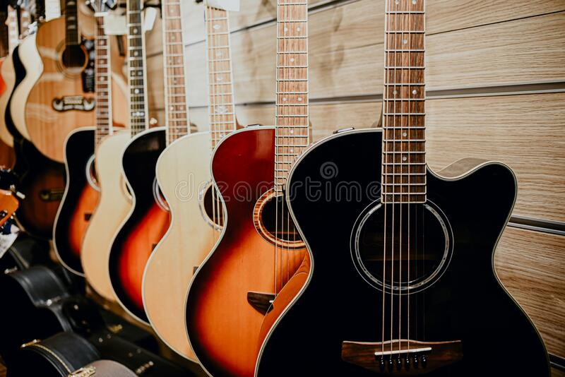 Guitar colorful wooden wall music store showcase royalty free stock photos