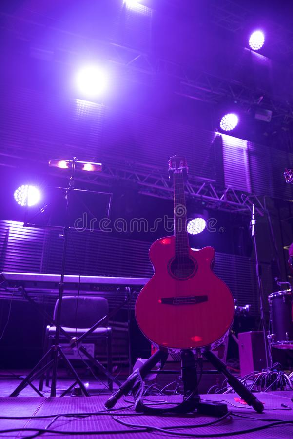 Guitar at a concert. On stage in the rays of light stock photo