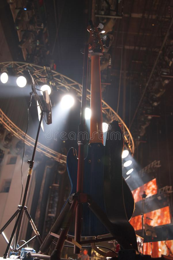 Guitar at a concert. On stage in the rays of light stock photos