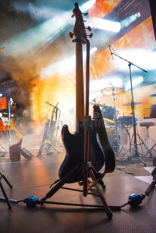 Guitar at a concert. On stage in the rays of light stock image