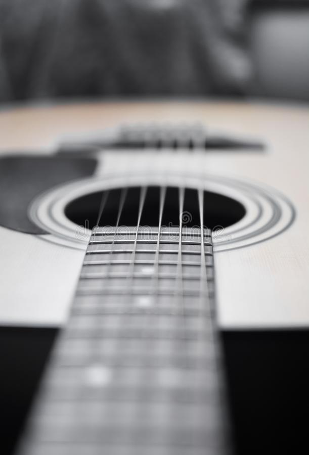 Guitar detail neck. Guitar detail closeup of fret and fretboard, pins and bridge pins, strings and saddle and sound hole royalty free stock photos