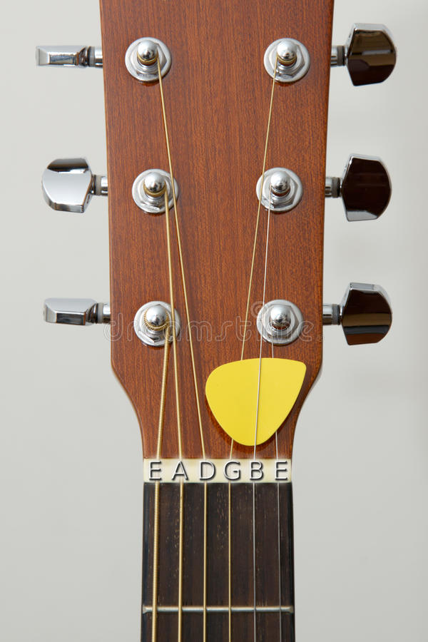 Guitar detail: tuning keys,hitchpins, note letters stock image